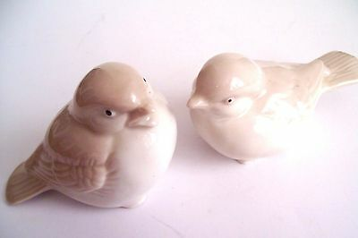 A Pair Of Porcelain Bisque Beige And White Birds Figurines