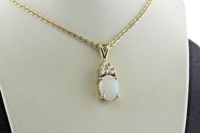 - 14K Yellow Gold Oval White Fire Opal & 0.10 TCW Diamond Mini Charm Pendant