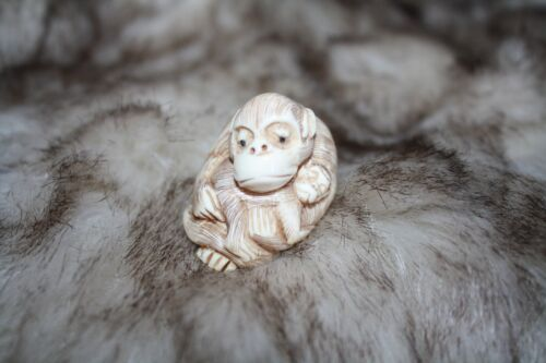 NETSUKE MOTHER CUDDLING BABY MONKEY