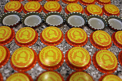 "100 ARCADE TOKEN ""A"" BREWERY BEER BOTTLE CAPS UNCRIMPED BRIGHT ORANGE YELLOW"