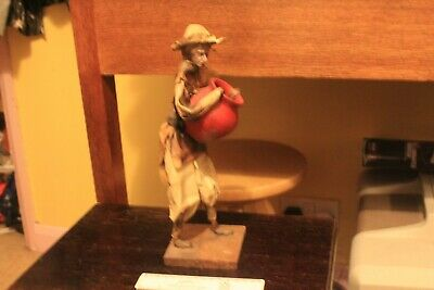 Large retro collectable paper-mache model of an old man carrying large pot