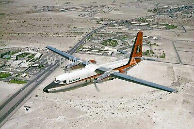 8X12 air-to-air Photo Bonanza Airlines F-27 N145L above the Dunes Casino