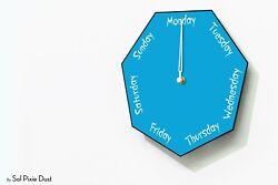 DayClocks - Hexagon Blue Wall Clock - Day of The Week Clock - Fun Clock Gift