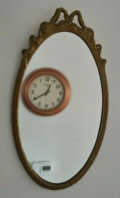 Small oval gilt mirror, rococo style. 42cm. In NW4