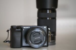 Sony A6000 with kit 16-50mm and telephoto 55-210mm lens for sale