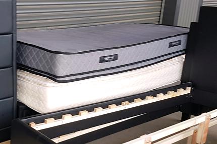 Two pillow top king single mattresses