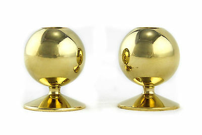 A pair of small solid brass candlesticks. Spherical. Vintage