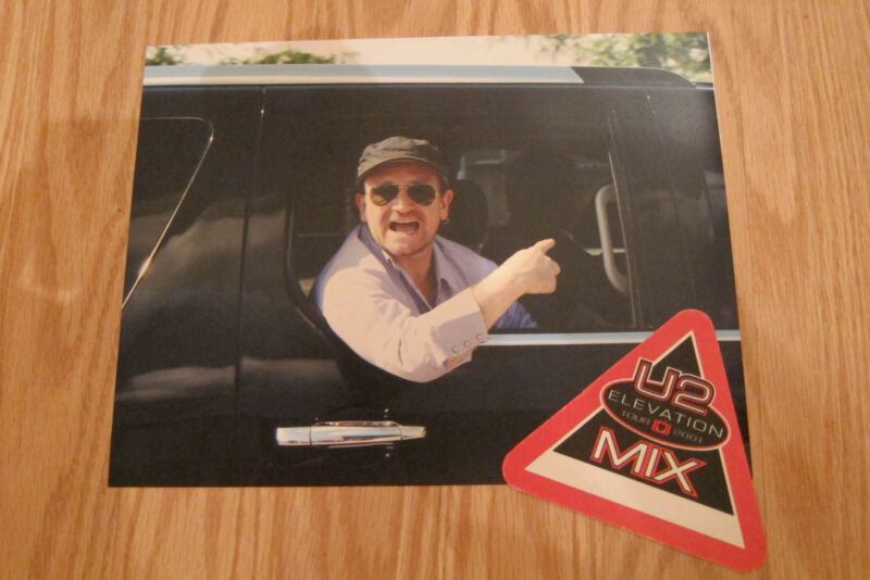 U2  - Bono candid photo from 2011 and 2001 tour credential