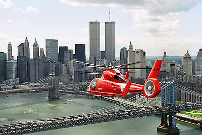 HH-65A Dolphin from Coast Guard Air Station Brooklyn flies by World Trade Center