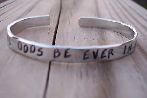 THE-HUNGER-GAMES-HAND-STAMPED-MAY-THE-ODDS-BE-EVER-IN-YOUR-FAVOR-CUFF-BRACELET