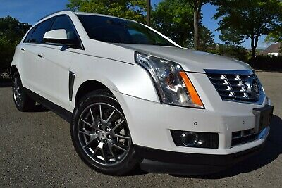 "2015 Cadillac SRX PREMIUM COLLECTION-EDITION(ALL OPTIONS) 2015 Cadillac SRX Premium SUV 3.6L/V6/Panoramic/Navigation/Sensors/Blis/20""/Sync"