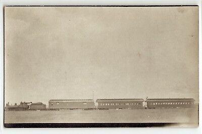 (Railroad train, engine, cars on prairie; c. 1915; real photo postcard RPPC )