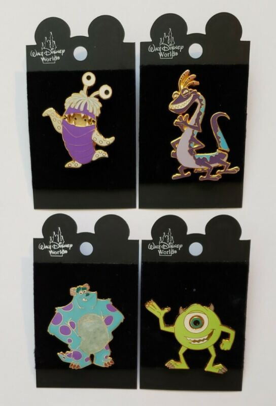 Lot of (4) Walt Disney Pins - Monsters Inc - Sulley , Boo , Randall & Mike
