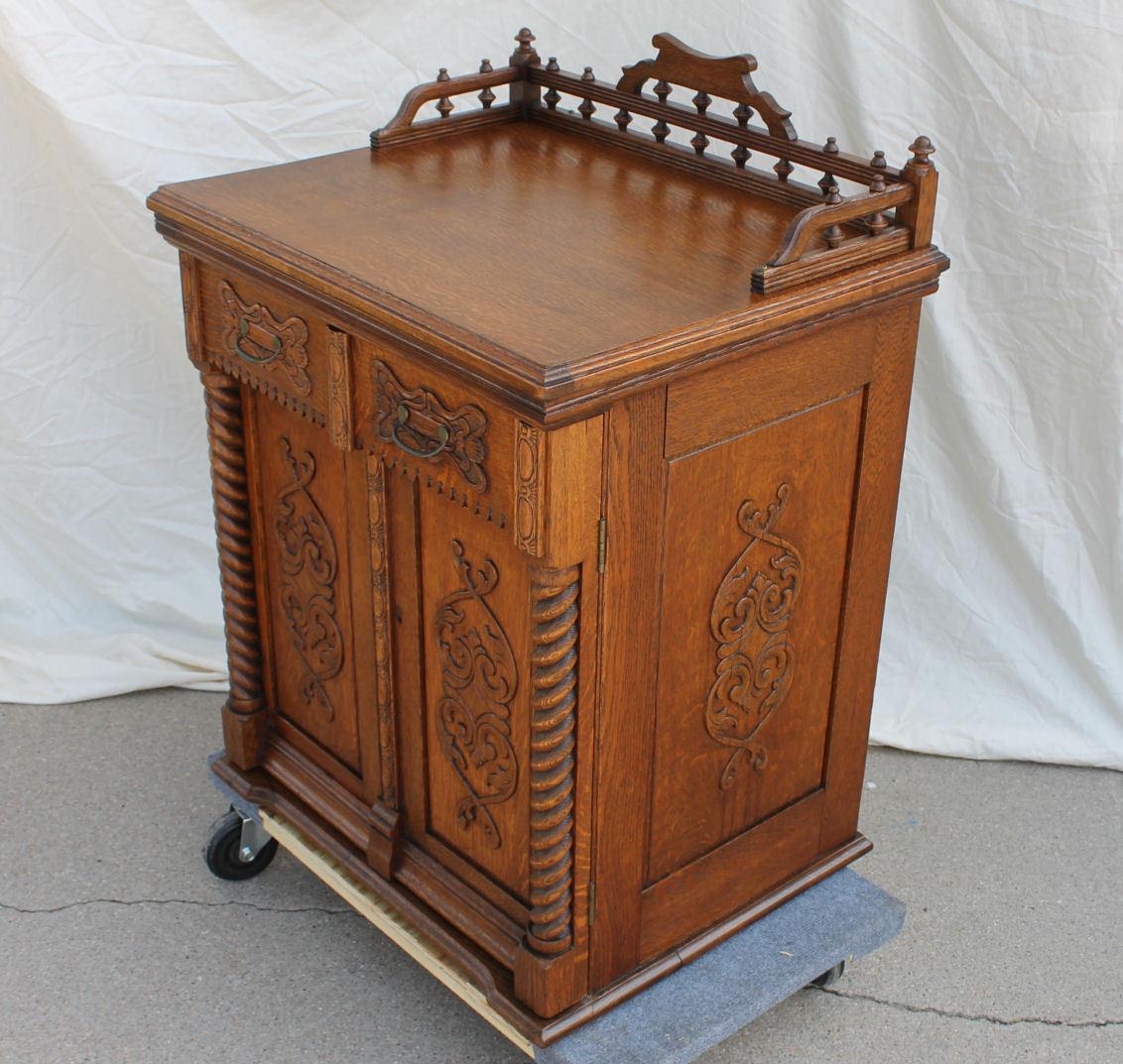 Fancy Antique Oak Sewing Machine Cabinet with Arlington machine