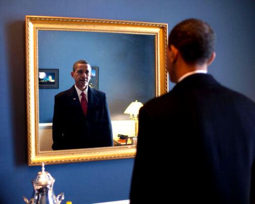 BARACK OBAMA CHECKS APPEARANCE BEFORE TAKING OATH OF OFFICE  8X10 PHOTO (DD-041)