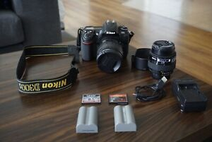 Nikon D300s with two lenses, 2 batteries, 2 8gb cards