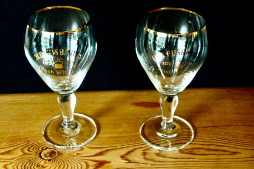 OLD BUSHMILLS IRISH WHISKEY GLASSES SET OF TWO FOOTED GOLD RIM NICE