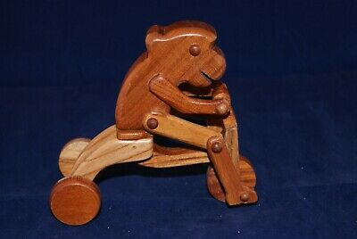 HANDMADE WOODEN CARVED MONKEY RIDING A TRICYCLE CHESTER WEDGEWOOD