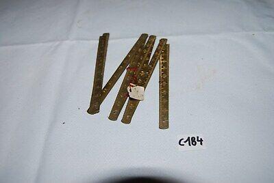 C184 Vieux outils - mini mètre - prix 38 frs - magasin