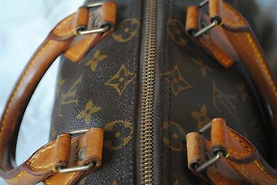 ff429c2f3ba4 FAKES have shinny yellow fabric or worse - they have fake logo fabric on  the inside. Serials numbers on old LV Speedy bags will be imprinted on ...