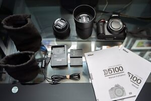 D5100 Nikon with kit lenses and extra battery