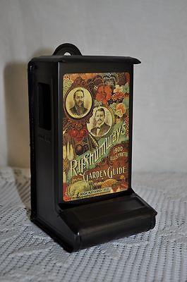 Black MATCH TIN Safe Holder RH SHUMWAY Flower Seedsman Vintage Advertisement
