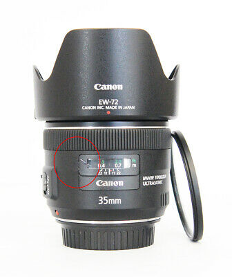 # Canon EF 35 mm f/2.0 IS USM Wide Angle Lens + Filter S/N 1137