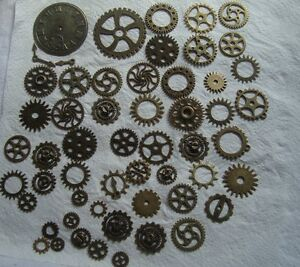 100 GRAMS OF STEAMPUNK COGS AND GEARS  IN BRONZE  METAL ALLOY FROM 40mm to 8mm
