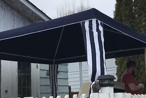 10ft.  x 10ft polyester sun canopy with 4 attachable walls