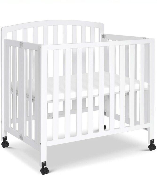 DaVinci Dylan Convertible Mini Crib in White New in box - local pickup