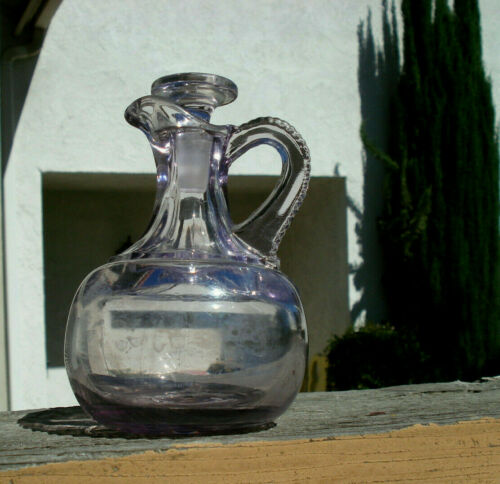 Vintage, sun-purpled, collectible glass cruet with stopper