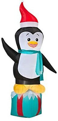 Gemmy Airblown Inflatable Penguin Wearing Santa Hat Standing On Blue Present 7Ft