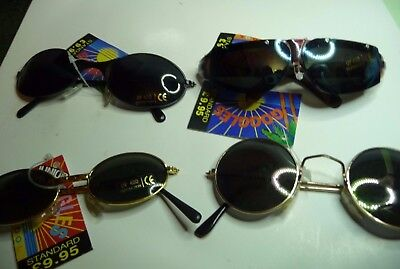 sun glasses Junior 4 pairs all new. retail at £9.95 each