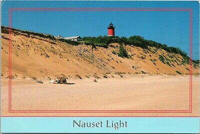 Cape Cod, Massachusetts lighthouse - Nauset Light with person on beach ()