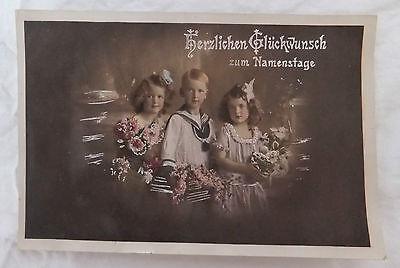 AK Glückwunsch zum Namenstag Fotokunst Kinder mit Blumen gel. 1915
