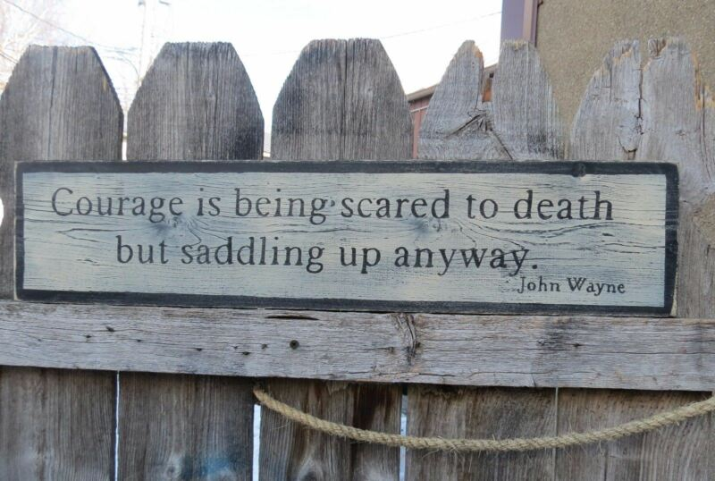 HP COURAGE IS BEING SCARED TO DEATH BUT SADDLING UP...  JOHN WAYNE QUOTE SIGN