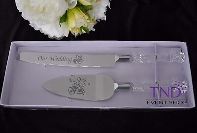 OUR WEDDING CAKE KNIFE AND SERVER SET EMBOSSED WITH BELL DESIGN - SILVER](Cake Knife Set)