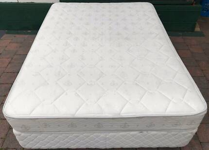 Excellent white double bed base with mattress. Delivery available