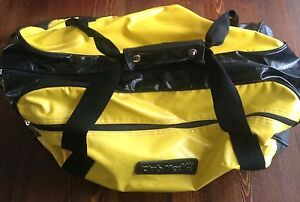 Yellow and black Club Med duffel bag