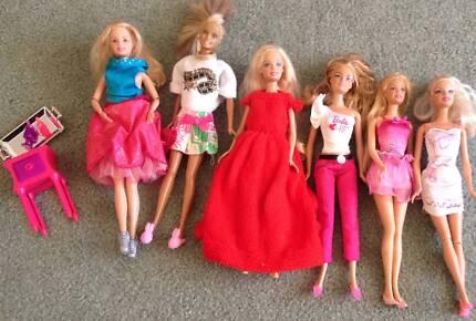6 Barbie Dolls
