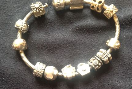 Silver Pandora Bracelet with charms.