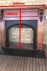 Timber Fireplace with Cast iron fascia
