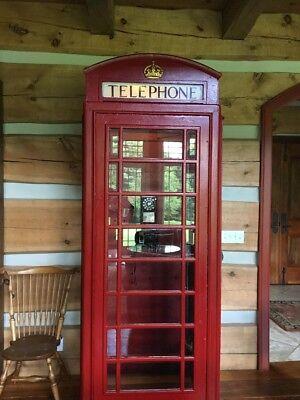 Red refurbished original British phone booth