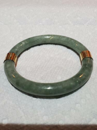 ANTIQUE HAND CARVED JADE BANGLE WITH TWO GOLD RINGS