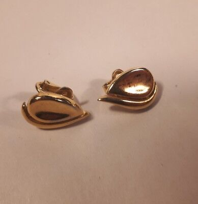 """a pair of vintage """"TRIFARI"""" clip on earring"""