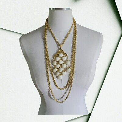 60s -70s Jewelry – Necklaces, Earrings, Rings, Bracelets Crown Trifari Waterfall Necklace White Lucite Bead Triple Strand Gold Tone 1960s $99.99 AT vintagedancer.com