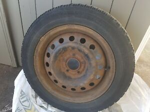 4 Steel rims, 5 bolt pattern, with used winter tires