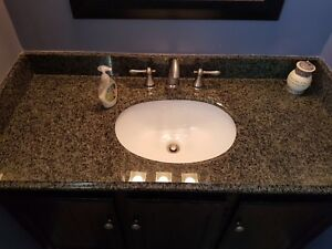 Granite counter top with taps and sink