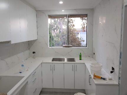 Looking for cheap splashback tiler (please visit my ad )