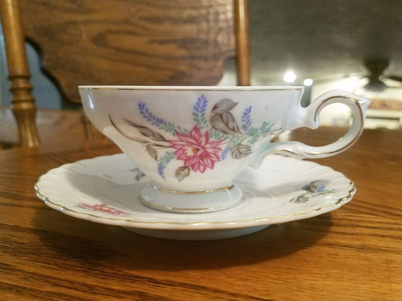 VINTAGE ROYAL SEALY CHINA FLORAL FOOTED TEACUP AND SAUCER! JAPAN